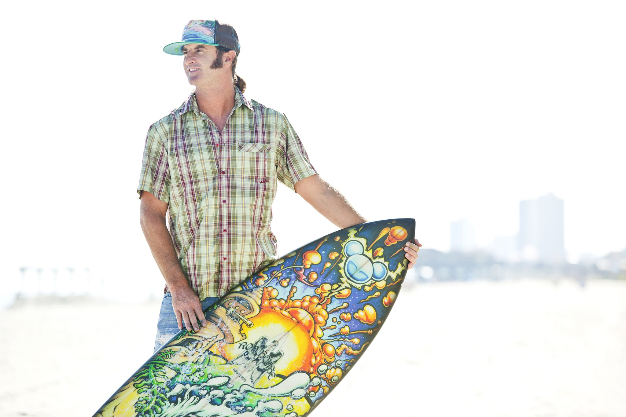 Drew Brophy and surfboard on beach Photo by Scott Smallin preview