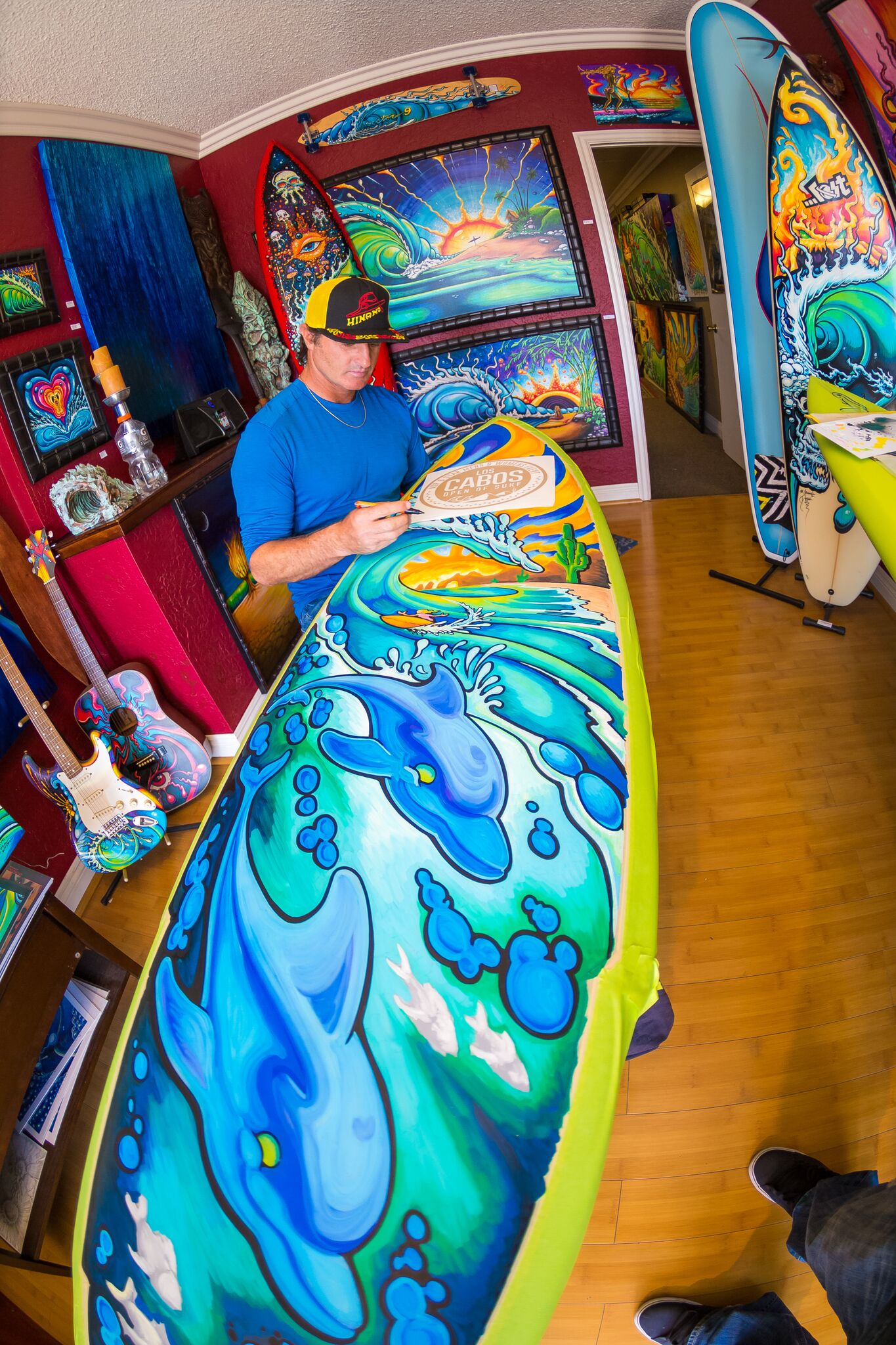 Drew Brophy painting Surfboard May 6 2014 PHOTO By Larry Beard preview