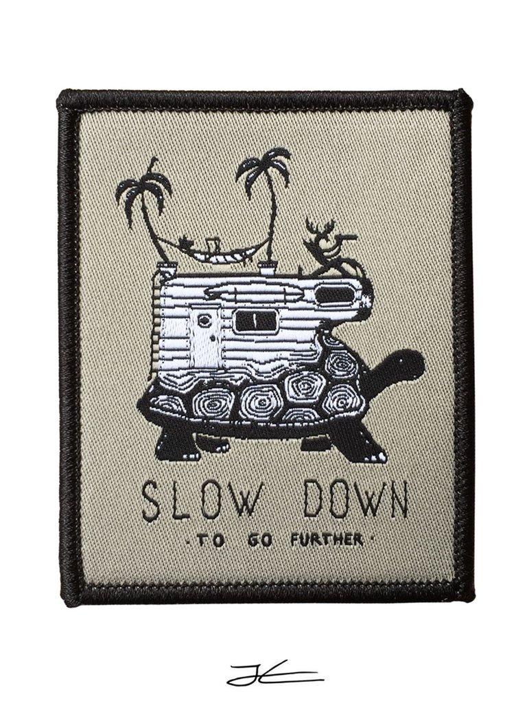 Slow Down Woven Patch Jonas Claesson 1024x1024 667fd480 93a5 4550 b2e0